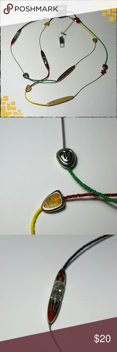 """Tribal Necklace Versatile necklace that can be worn doubled or a single long strand.  54"""" long with 3"""" extender.  Seed, acrylic and metal beads on coil wire strand with metallic and enameled charms.  NWT Excellent condition. Pilgrim Danish Design Jewelry Necklaces"""