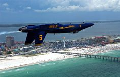 One of the Blue Angels flying upside-down over Pensacola Beach. Photo courtesy of Days Inn Pensacola Beachfront Hotel.