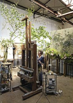 Bringing the outside in.. The green foliage really sets off this studio and check out the giant easel!