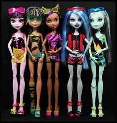 I collect dolls and photograph them... here are my Monster High Gloom Beach girls.  :o)