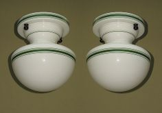 2 all glass flush mount ceiling globes with green stripes.