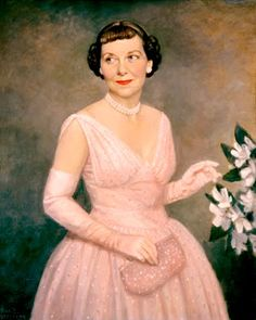 Mamie Eisenhower - First lady to Dwight Eisenhower, from 1953 to 1961.  She could wear beautiful dresses but did not know how to wear a flattering hair style.