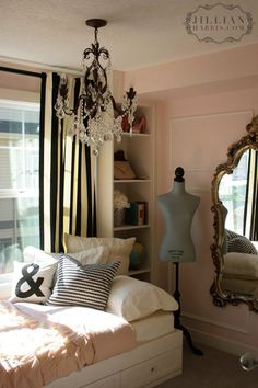 Girls bedroom - soft pink walls - black & white drapes - gold ornate mirror. Love the chandelier. And shelves.