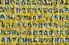 "Oct. 15, 2014. Portraits of the victims of the sunken South Korean ferry ""Sewol"" are seen with yellow ribbons at Gwanghwamun square where relatives of the victims have been sitting in protest against the government, in Seoul."
