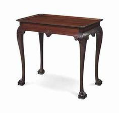 A CHIPPENDALE CARVED MAHOGANY TRAY-TOP TEA TABLE