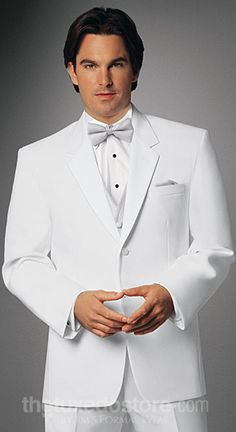 White tux with silver vest - how handsome! If you want the best officiant for your Outer Banks, NC, ceremony, contact Rev. Barbara Mulford: myobxofficiant.com/