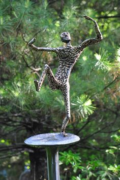 """Things Not Seen"" Like that dancing on the head of a pin. Steel with bronze. Pin is 6 feet, Dancer 1 foot."