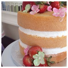 Garden theme -bridal shower -flowers and cupcakes -cake pops and candy -beautiful center pieces -cake by our friend from Ambrosia Bakery