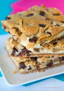Chocolate Chip Cookie Cheesecake Bar Recipe A few months ago I tried the most amazing dessert made by my friend Mary who blogs over at Barefeet In The Kitchen.  Chocolate Chip Cookie Cheesecake Bars.  These...