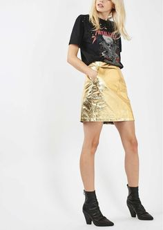 Light up the room with this megawatt faux-leather miniskirt foiled in a gleaming goldtone finish.