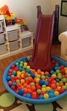 Sweet playroom design with a swing and colorful ball pit