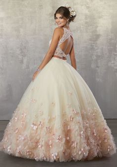Fun and Feminine, This Quinceañera Ballgown Beautifully Combines a Beaded Lace Bodce and Full Ballgown Skirt Accented in Three Dimensional Flowers.