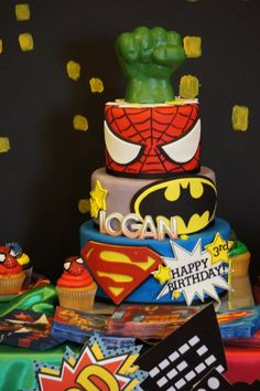 Superhero Cakes -- Design Dazzle - but it bugs me that they mixed DC with Marvel.  Yep.  I'm a nerd.