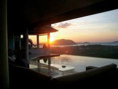 View to a beautiful sunrise in with islands in Chalong Bay from a luxury villa in Rawai.