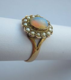 antique victorian opal and pearl flower ring, 1879.