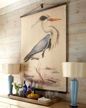 perfect coastal chic for a beach cottage: art  (blue heron tapestry) & weather-bleached shiplap siding