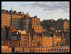 A beautiful view of Edinburgh Old Town buildings bathed in the golden evening light. We visited here in August 2009.