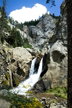 """Boulder Falls is located 11 miles west of Boulder, on the north side of Boulder Canyon Drive (SR 119) between Boulder and Nederland. It consists of five acres of mining claims that were given to the City of Boulder by Charles G. Buckingham, president and co-founder of Buckingham Brothers Bank (now Norwest Bank). Buckingham had held a U.S. Patent since 1881 on the American Mill site that included the Falls. He donated it to the City of Boulder for recreational purposes in 1914, hence """"saving…"""