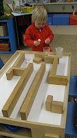 Make mazes with blocks and try to blow cotton balls through it