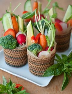 Repurposed baskets make adorable crudite holders. Click through for more summer party ideas.