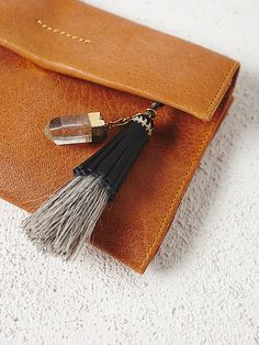 Black + Jane Horsehair + Tassel Keychain at Free People Clothing Boutique
