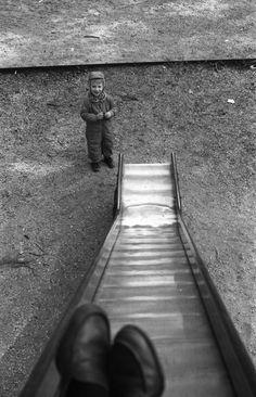 """Vivian Maier, """"Highland Park, IL (Self-Portrait, Vivian on Slide)"""" (c. 1961–65)"""