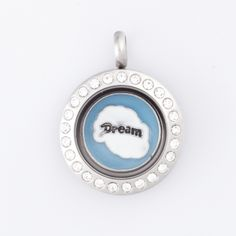 """Smashing Fancy   Cute and thoughtful gift for grads this season, and even Mom's!   This locket includes the following:  ~ 1 Miniature Silver Locket with Crystals   ~ 1 """"Dream"""" Round Blue Charm"""