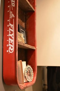 An old red wagon repurposed into a shelf