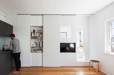 Darlinghurst Apartment, Sydney.  Design by Bard Hurst the 27sqm apartment is a fully functional home for two.  Each element has been considered to maximise storage and functionality. Like the sliding door to provide seclusion and delineate areas.