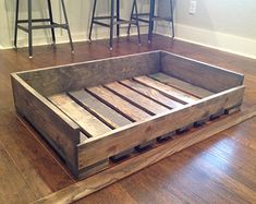 Your will be relaxing in style with this handmade reclaimed pallet dog bed. This dog bed is created from new pallets but with the look of an old, reclaimed pallet. It fits a standard crate pad. Options for custom dog beds are available. Select your wo Rustic Dog Beds, Wood Dog Bed, Pallet Dog Beds, Diy Dog Bed, Dog Bed From Pallets, Dog Bed Frame, Homemade Dog Bed, Farmhouse Dog Beds, Pallet Dog House