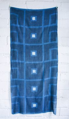 """Block Shop Hand Printed Scarf: Blue, 25% silk 75% cotton, 34"""" x 86"""", $120  -  BLOCK SHOP IS A TEXTILE COMPANY THAT MARRIES THE TRADITIONAL INDIAN HAND BLOCK PRINTING PROCESS WITH A MODERN CALIFORNIA AESTHETIC. THESE SCARVES ARE HAND PRINTED BY 5TH GENERATION MASTER PRINTERS IN INDIA WITH NATURAL DYES. SLIGHT VARIATION IN PRINTING AND COLOR ARE HALLMARKS OF HAND BLOCK PRINTING WITH NATURAL DYES. NATURAL SELVEDGE ON LONG SIDES, RAW EDGE ON ENDS. CAN BE WORN AS A SCARF OR AS LIGHT WEIGHT…"""