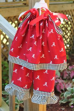 Awww, someone pinned my outfit on Pinterest. :)  Alabama Pillowcase Dress and Ruffle Pants Set by MommyWebster.
