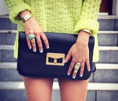 love everything about this: the bright slouchy sweater in contrast with the dark GORGEOUS leather clutch and the rings matching the nail polish. this would be perfect with black leather shorts.