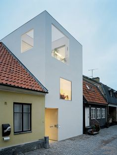 ::ARCHITECTURE:: I absolutely love the juxtaposition of the old and the new in this townhouse project in Landskrona by Elding Oscarson.