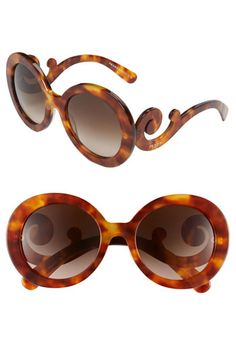 If only I had hundreds of dollars to spend on sunnies. Prada.