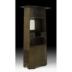 ENGLISH ARTS & CRAFTS  Tall cabinet with mirror, England, ca. 1915