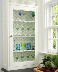 chicken wire cabinet door inserts... use old chippy window too