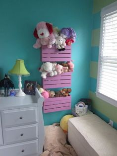 stuffed animal storage! Crates cut in half and mounted to the wall.we need this!