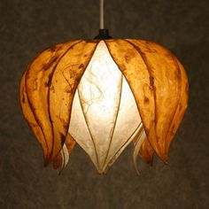 Richly fibered gold petals encase soft, ivory petals creating a bold yet warm and ambient glow. We ship our Hanging Lotus Flower shade with a 15 foot standard Ikea hanging lamp cord. You can safely use up to 75 watts with this shade.