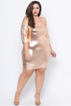 """This plus size, stretch knitmetallic bodycon dress features an elasticized off the shoulder neckline, 3/4 sleeve, a bodycon silhouette, and side seams for a more fitted style. Made in USA Content + Care 96%Polyester4% Spandex Hand wash cold  ModelMeasurement Wearing a Size3X Height:6'0"""" Bust: 47"""" Waist: 39.5"""" H"""