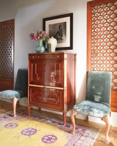 Entry of Michael S. Smith's penthouse apartment. Russian neoclassical secretary. 19th century Samarqand rug. Design by Michael S. Smith