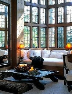 One of my favorite things about the English Tudor Manor house is the wall of stacked windows...****stunning !! i would even do with a small version of this....a little alcove by the windows to read by !