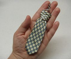 Tiny tie keyring - finished project by greenbeanscrafterole, via Flickr.  I was thinking wine tie for gift ideas