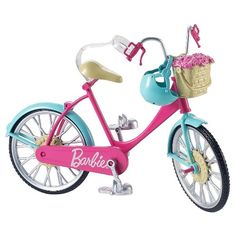 This Barbie bicycle is ready to ride into imagination! A pink body, teal fenders and silvery accents are oh-so-pretty. Real working pedals and wheels make bike riding a breeze. Place Barbie doll (sold separately) on the bike seat where a clip holds her in place. Slide her feet into the pedals and her hands onto the handlebars, then push to see the doll ride! A blue helmet keeps Barbie doll safe. And a basket of pink flowers at the front dresses up her bicycle, too! They can be taken in and…