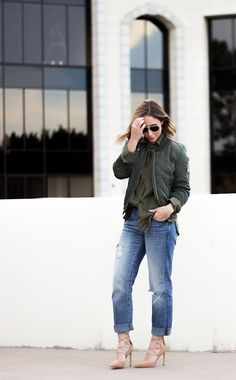 The Classic Utility Shirt You Need For Spring | Clothes & Quotes. Khaki utility shirt+distressed jeans+camel lace-up pumps+khaki bomber jacket+sunglasses. Winter To Spring Transition Casual Outfit 2017