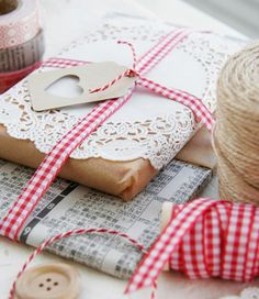 Brown paper, doilies, red & white ribbon