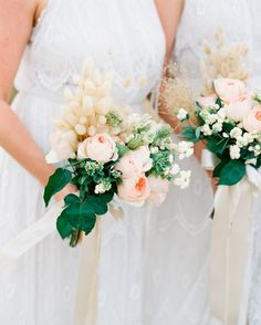 Keeping with the soft-blush-and-peach color palette of this Australian wedding, Natural Art Flowers by Rebecca Grace made each bridesmaid bouquet with peach and pink roses, milk berries, Queen Anne's lace, and pussy willow.