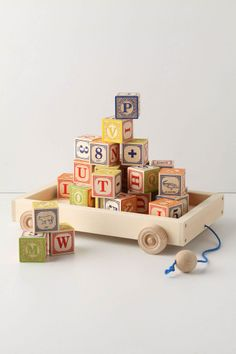 Alphabet Wagon from Anthropologie:  Classic embossed alphabet blocks get ready to roll in a tiny wooden cart. By Uncle Goose.  #kids #toys #gifts