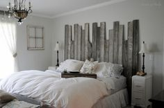 "Rustic headboard made from reclaimed barn wood. Connected at various heights for an added rustic element to a romantic farmhouse bedroom. By ""Buckets of Burlap."""