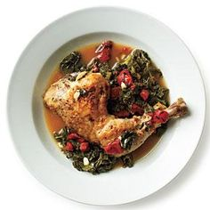 Bake chicken leg quarters in a broth mixture along with kale and tomatoes for an easy one-dish dinner.